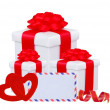 Stock Photo: White gift box with red bow, two hearts and greeting card isolat