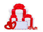 White gift box with red bow, two hearts and greeting card isolat — Stock Photo