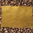 Coffee beans background and old paper — Foto de Stock