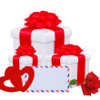 Stock Photo: White gift box with red bow, two hearts, rose and greeting card