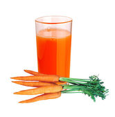 Carrot juice in glass and few fresh carrots isolated on white — Stock Photo