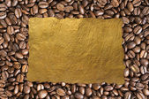 Coffee beans background and old paper — Stock Photo