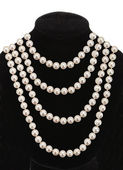 Pearl necklace on black mannequin isolated on white background — Stock Photo
