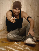 Bad man - drug dealer with syringes and with drugs — Stock Photo