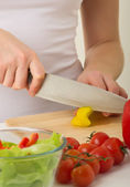 Human hands cooking vegetables salad in kitchen — Foto de Stock