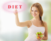 Beautiful girl with vegetable salad choose diet — Stock Photo