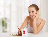 Woman writes a love letter - a card for valentines day — Stock Photo