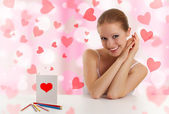Beautiful girl with a postcard valentine — Stock Photo
