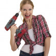 Funny beautiful girl with a drill drills head — Stock Photo