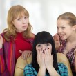 Three girls girlfriends talking about shopping - Stock Photo