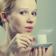 Beautiful girl enjoying a cup of coffee — Stock Photo