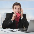 Frightened frustrated business man talking on the phone — Stock Photo