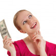 Cheerful dreamy girl in a red blouse holds the money, American d — Stock Photo #9487384