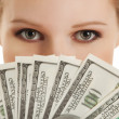Face of beautiful young woman and the money- dollars — Stock Photo