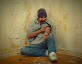 Bad guy - addict with a syringe using drugs — Stock Photo