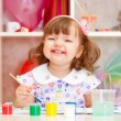 Little girl paints paints — Stock Photo