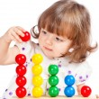 Stock Photo: Little girl playing with balls