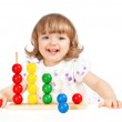 Little girl playing with balls — Stock Photo