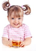 Little girl drinking apple juice — Stock Photo
