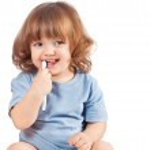 Little girl brushes her teeth, isolated — Stock Photo
