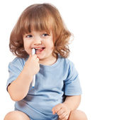 Little girl brushes her teeth, isolated — Stock Photo