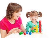 Mom plays with her daughter — Stock Photo