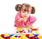 Child plays in developing games — Stock Photo