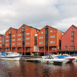 Restored warehouses on stilts over the river in Trondheim. — Stock Photo
