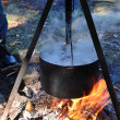 Stock Photo: Close-up of a cauldron on the campfire.
