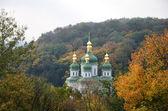 Orthodox church in the autumn park. — Stock Photo