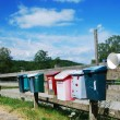 Stock Photo: Country mailboxes on fence