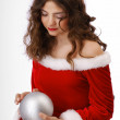 Pensive teenage girl with christmas ball — Stock Photo