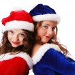 Happy teenage santa clauses — Stock Photo