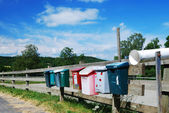 Country mailboxes on the fence — Stock Photo