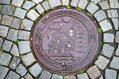 Sewer manhole on stone pavement of Trondheim. — Stock Photo