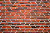 Wall with reddish-brown brick — Stock Photo