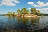 Scandinavian lake with small island — Stock Photo
