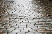 Wet block-stones of sett paving — Stock Photo