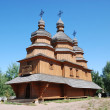 Photo: Wooden Orthodox church with ancient cemetery.