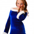 Shy teenage girl in suit of Santa Claus — Stock Photo