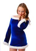 Verlegen tienermeisje in pak van santa claus — Stockfoto