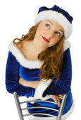 Dreamy teenage girl in suit of Santa Claus — Stock Photo