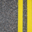 Close-up of road surfacing with lane lines - Stock Photo