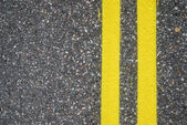Close-up of road surfacing with lane lines — Stock Photo
