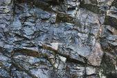 Texture of mountain wet rock — Stock Photo