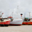 Foto de Stock  : Fishing boats on the sand coast.