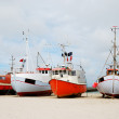 图库照片: Fishing boats on the sand coast.