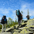 Hikers climbing up the mountain. — Stock Photo
