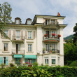 Swiss mansion in the middle of verdure. — Stock Photo