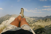 Male Legs Relaxing at the Summit — Stock Photo